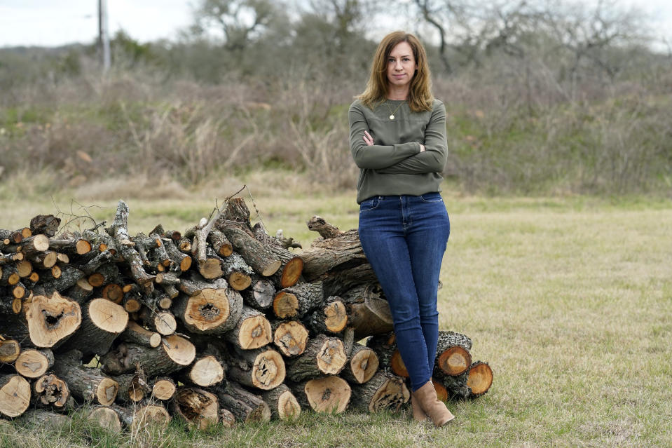 Rachel Van Lear poses for a portrait at her home in Buda, Texas, Tuesday, March 9, 2021. On the same day a global pandemic was declared, she developed symptoms of COVID-19. A year later, she's still waiting for them to disappear. And for experts to come up with some answers. (AP Photo/Eric Gay)