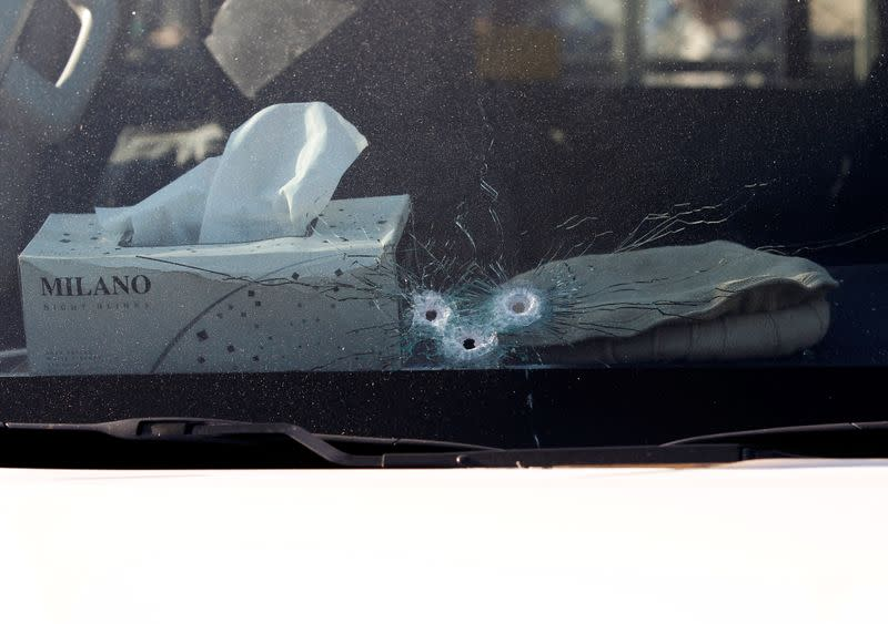 Bullet holes are seen in the window of the vehicle carrying Japanese doctor Tetsu Nakamura after an attack in Jalalabad