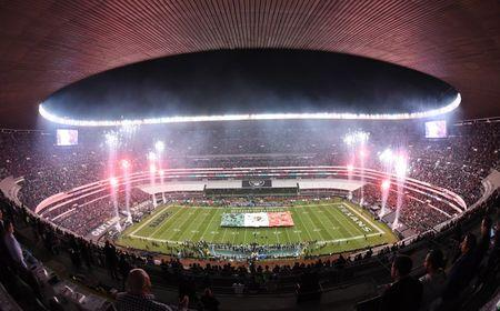 Nov 21, 2016; Mexico City, MEX; General overall view of a Mexican flag on the field and fireworks during the playing of the Mexico national anthem before a NFL International Series game between the Houston Texans and the Oakland Raiders at Estadio Azteca. Mandatory Credit: Kirby Lee-USA TODAY Sports