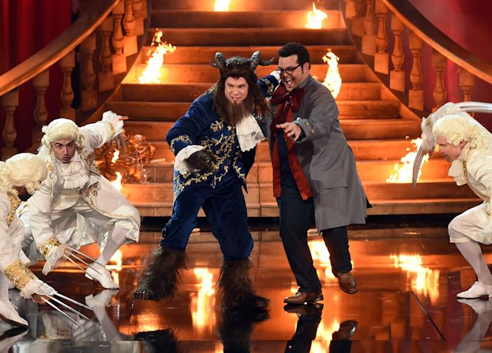 Host Adam DeVine (L) and actor Josh Gad perform onstage during the 2017 MTV Movie And TV Awards at The Shrine Auditorium on May 7, 2017 in Los Angeles, California.u