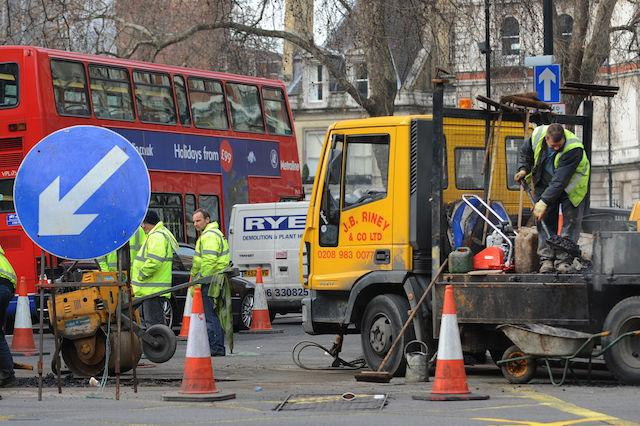 Embargoed to 2230 Friday September 1 File photo dated 14/02/09 of roadworks a road in central London, as utility companies would be charged by the hour for digging up busy roads in England under Government proposals.