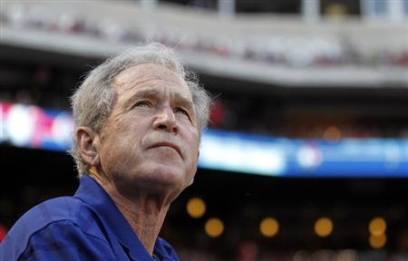 Former U.S. president George W. Bush watches before the start of the MLB American between the Rangers and White Sox in Arlington, Texas