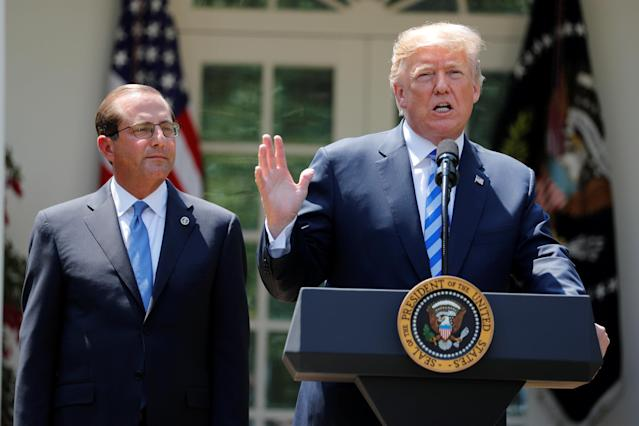 Secretary of Health and Human Services Alex Azar looks on as President Donald Trump speaks during an event about prescription drug prices in the Rose Garden of the White House, Friday, May 11, 2018, in Washington. (AP Photo/Evan Vucci)