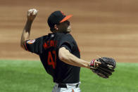 Baltimore Orioles starting pitcher John Means delivers a pitch against the Texas Rangers in the third inning during a baseball game on Sunday, April 18, 2021, in Dallas. (AP Photo/Richard W. Rodriguez)