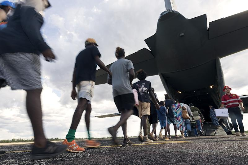 Residents of McArthur River, a remote town in the Northern Territory, boarding an Australian military plane as authorities evacuate communities in the path of a powerful cyclone (AFP Photo/CPL TRISTAN KENNEDY)