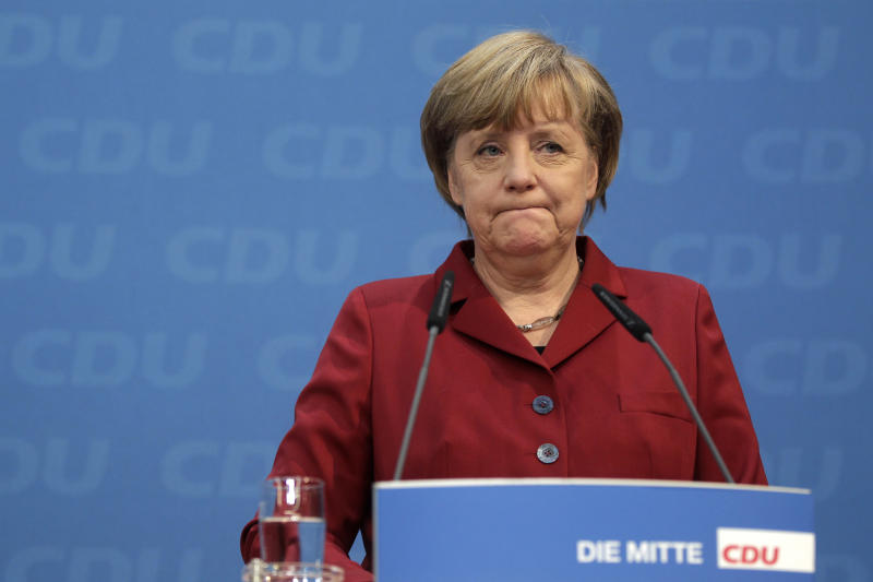 German Chancellor and chairwoman of the German Christian Democrats, CDU, Angela Merkel attends a press conference after the party's weekly executive committee meeting in Berlin, Germany, Monday, Jan. 21, 2013. German Chancellor Angela Merkel says a state election loss months before a national vote was painful — but she's downplaying the implications for her quest for a third term. (AP Photo/Michael Sohn)