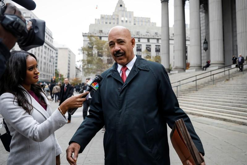 Theodore Wells, the lawyer for Exxon, speaks to a reporter after exiting New York State Supreme Court in New York