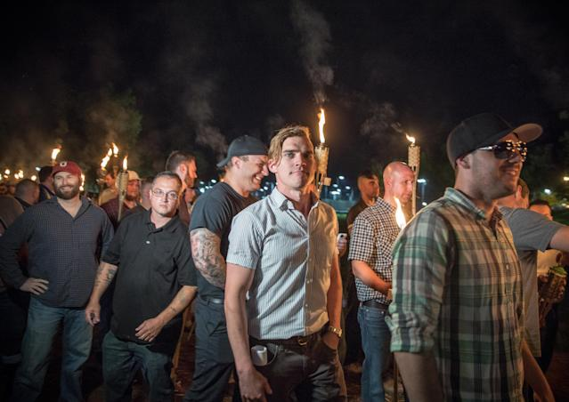 """<p>Chanting """"White lives matter! You will not replace us! and Jews will not replace us!,"""" several hundred white nationalists and white supremacists carrying torches marched in a parade through the University of Virginia campus last night.<br> Beginning a little after 9:30 p.m., the march lasted 15 to 20 minutes before ending in skirmishing when the marchers were met by a small group of counterprotesters at the base of a statue of Thomas Jefferson, the universitys founder. (Photo: Evelyn Hockstein/For The Washington Post via Getty Images) </p>"""