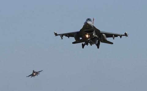 US jets have uneasily shared Syrian airspace with Russian and regime aircraft - Credit: AP Photo/Ahn Young-joon