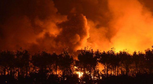 Flames engulf the skies at Chinese port city Tianjin after a warehouse blast last August. Picture: AFP