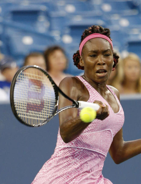Venus Williams, from the United States, returns to Jana Cepelova, from Slovakia, during a match at the Western & Southern Open tennis tournament on Monday, Aug.12, 2013, in Mason, Ohio. (AP Photo/David Kohl)
