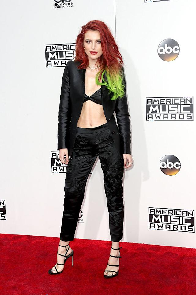<p>Bella Thorne paired her wild new hair with a black look consisting of just a bra as a top, tapered pants, and an open blazer. <em>(Photo: Getty Images)</em> </p>