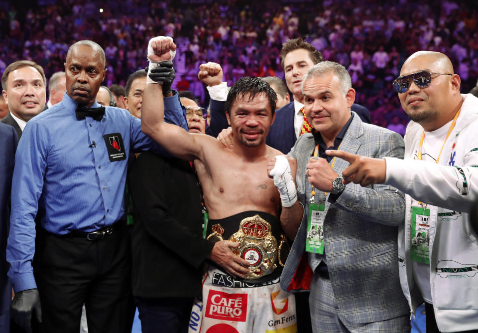 LAS VEGAS, NEVADA - JULY 20:  Manny Pacquiao (C) poses with members of his team and referee Kenny Bayless after defeating Keith Thurman by split decision in a WBA welterweight title fight at MGM Grand Garden Arena on July 20, 2019 in Las Vegas, Nevada.  (Photo by Steve Marcus/Getty Images)