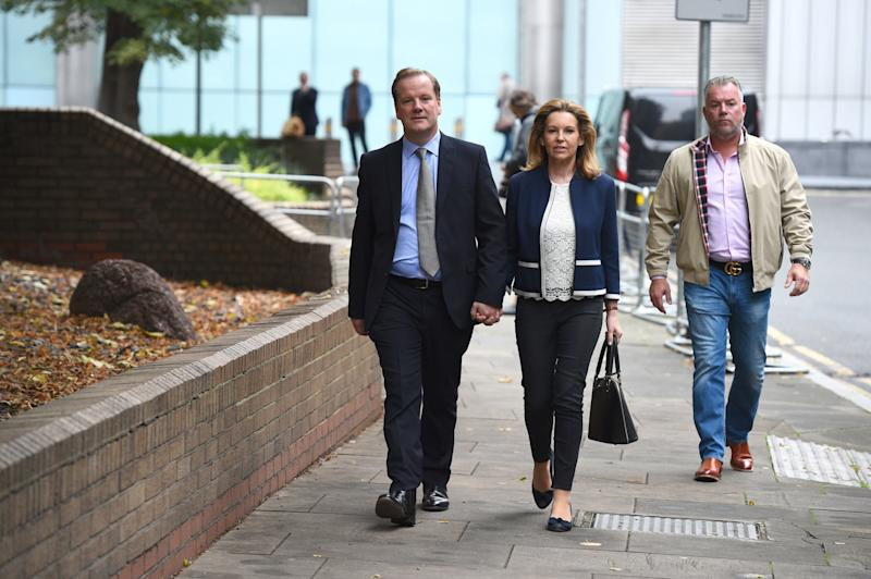Conservative MP for Dover Charlie Elphicke, with his wife Natalie Ross, leaving Southwark Crown Court in London (PA)