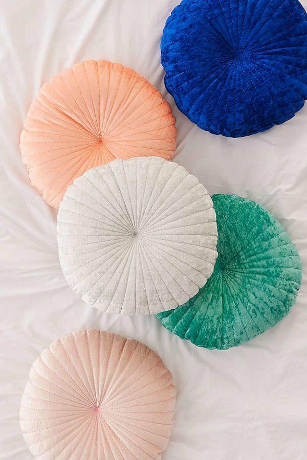 "Get it <a href=""https://www.urbanoutfitters.com/shop/shelly-round-velvet-pillow?category=decorative-pillows-throw-blankets&color=067"" target=""_blank"">here</a>."