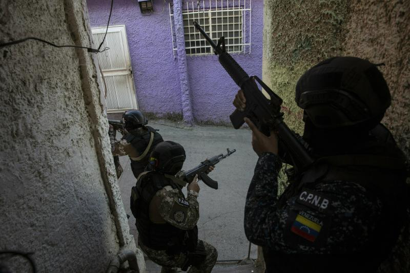 Members the National Police Action Force, or FAES, an elite commando unit created for anti-gang operations, patrol the Antimano neighborhood of Caracas, Venezuela, Tuesday, Jan. 29, 2019. Rights groups say the unit is now acting against disaffected youths living in the slums. (AP Photo/Rodrigo Abd)