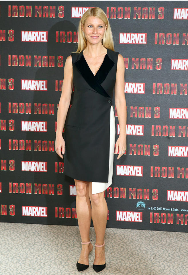 "A few days later, the Goop.com guru arrived at the London premiere of ""Iron Man 3"" in this sensible-yet-stylish Christian Dior wrap dress, complete with asymmetrical hemline. Black-and-pink ankle strap sandals added a bit of sass. (4/17/2013)"