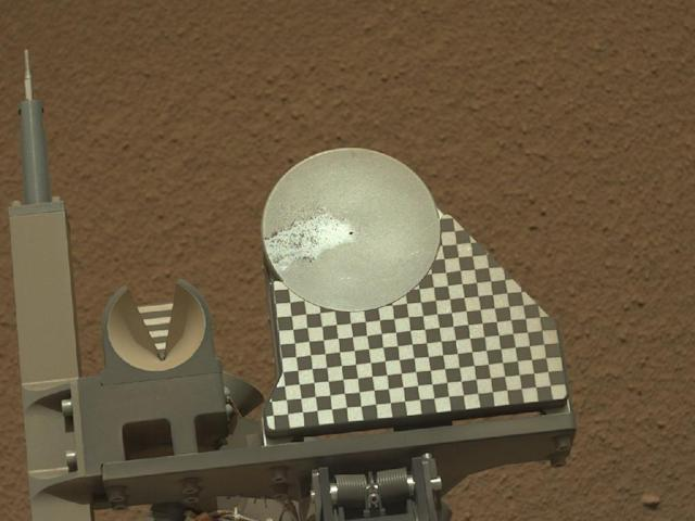 The robotic arm on NASA's Mars rover Curiosity delivered a sample of Martian soil to the rover's observation tray for the first time during the mission's 70th Martian day, or sol (Oct. 16, 2012). This image taken later that same sol by the rover's left Mast Camera shows the sample on the tray. The tray is 3 inches (7.8 centimeters) in diameter. (NASA)