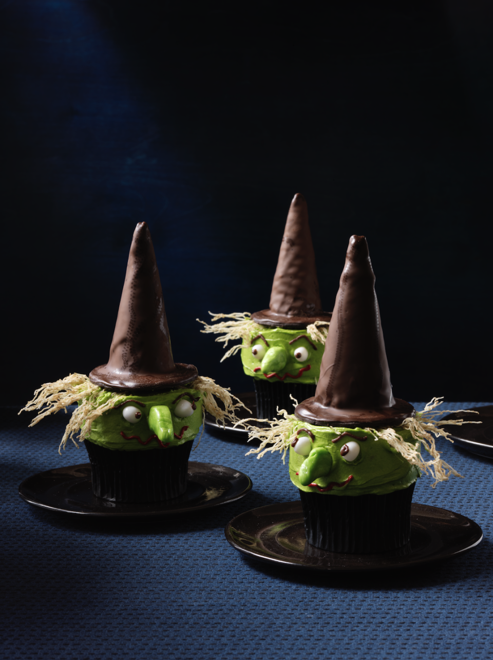 """<p>Put a spell on your guests with these bewitching treats, which elevate homemade vanilla cupcakes with a combo of chocolaty store-bought goods, frosting and candy.</p><p><em><a href=""""https://www.womansday.com/food-recipes/food-drinks/recipes/a11951/witch-cupcakes-recipe-123434/"""" rel=""""nofollow noopener"""" target=""""_blank"""" data-ylk=""""slk:Get the recipe from Woman's Day »"""" class=""""link rapid-noclick-resp"""">Get the recipe from Woman's Day »</a></em></p>"""