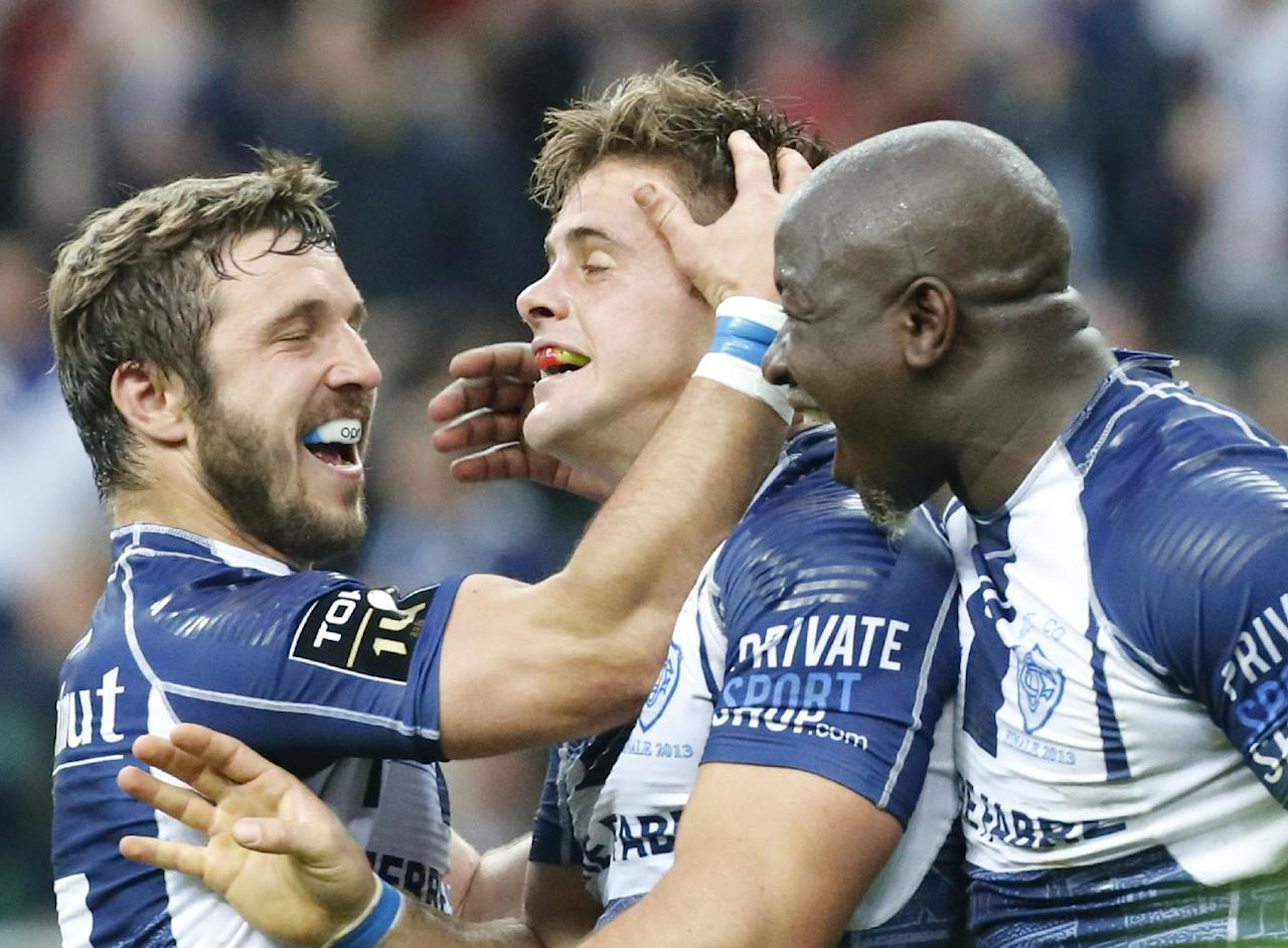 Rory Kockott of Castres, center, celebrates after scoring a try with his teammate against Toulon during their Top 14 final rugby match, at Stade de France stadium in Saint Denis, north of Paris, France, Saturday, June 1 2013. (AP Photo/Jacques Brinon)