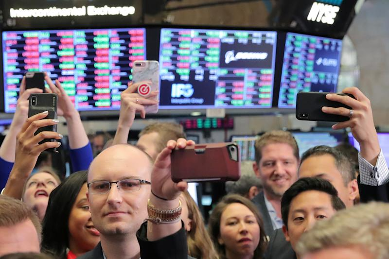 Guests use their phones during the Pinterest Inc. IPO on the floor of the New York Stock Exchange (NYSE) in New York, U.S., April 18, 2019. REUTERS/Brendan McDermid
