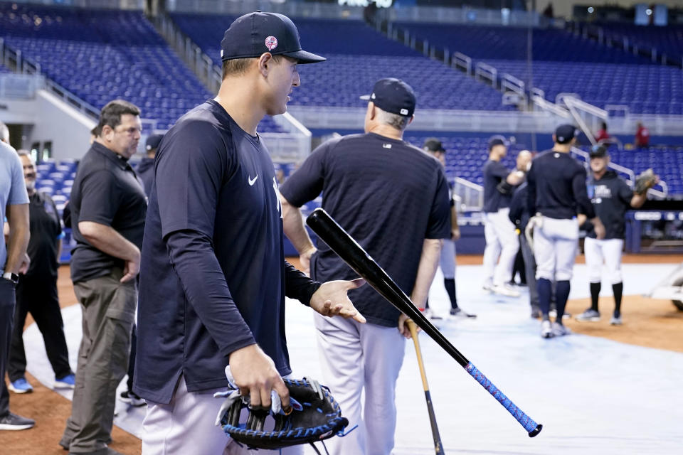 New York Yankees first baseman Anthony Rizzo walks onto the field before the team's baseball game against the Miami Marlins, Friday, July 30, 2021, in Miami. Rizzo was acquired in a trade from the Chicago Cubs. (AP Photo/Lynne Sladky)