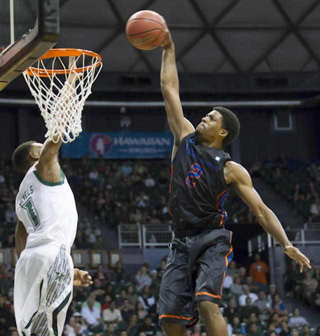 Boise State guard Derrick Marks (2) dunks the basketball on Hawaii guard Garrett Nevels (1) in the first half of an NCAA college basketball game at the Diamond Head Classic Sunday, Dec. 22, 2013, in Honolulu. (AP Photo/Eugene Tanner)