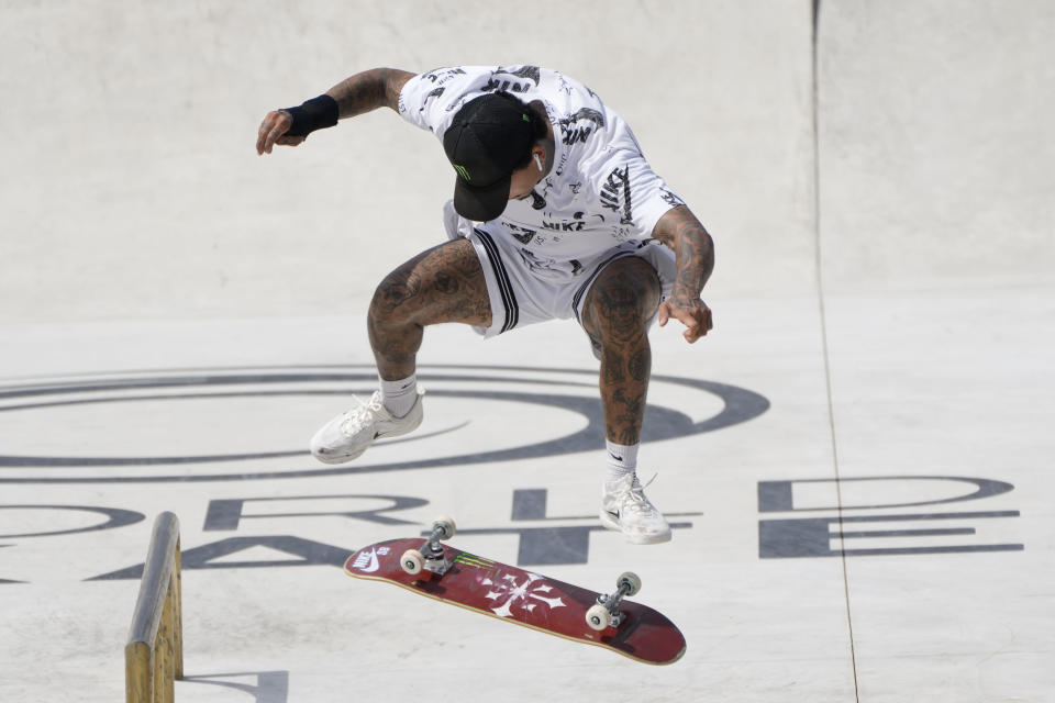 FILE - In this June 6, 2021, file photo, Nyjah Huston, of the United States, competes in a Street Skateboarding World Championships final, a qualifying event for Tokyo Olympic Games, in Rome. Skating is one of four debut Olympic sports, along with karate, surfing and sport climbing. (AP Photo/Alessandra Tarantino, File)
