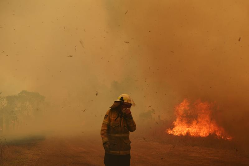 Firefighters battle a spot fire in Hillville, Australia.