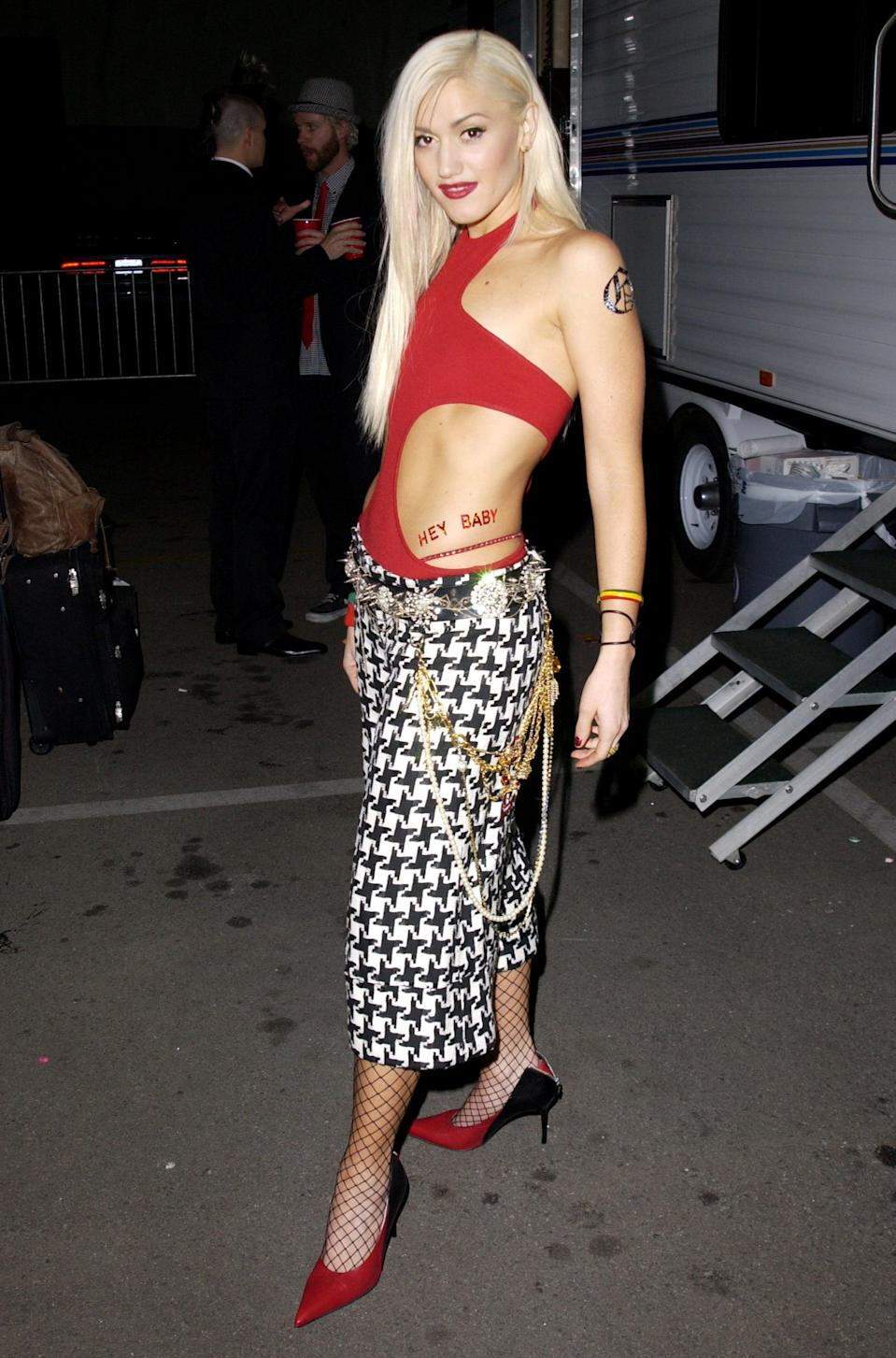 <p>At the 2001 My VH-1 Music Awards wearing a red bodysuit and checkered pants.</p>