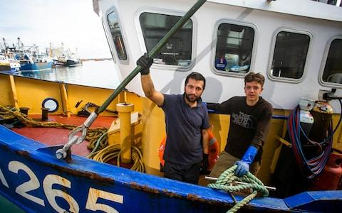 Fishermen Callum Clark and Nathan Clark onboard Joanna C at the Brixham Harbour in Devon after they were attacked - Credit: SWNS.com