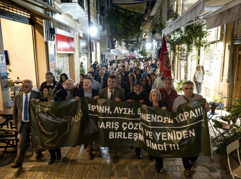 Cypriot demonstrators from both sides of the divided island marched in Nicosia to call for progress in reunifications talks