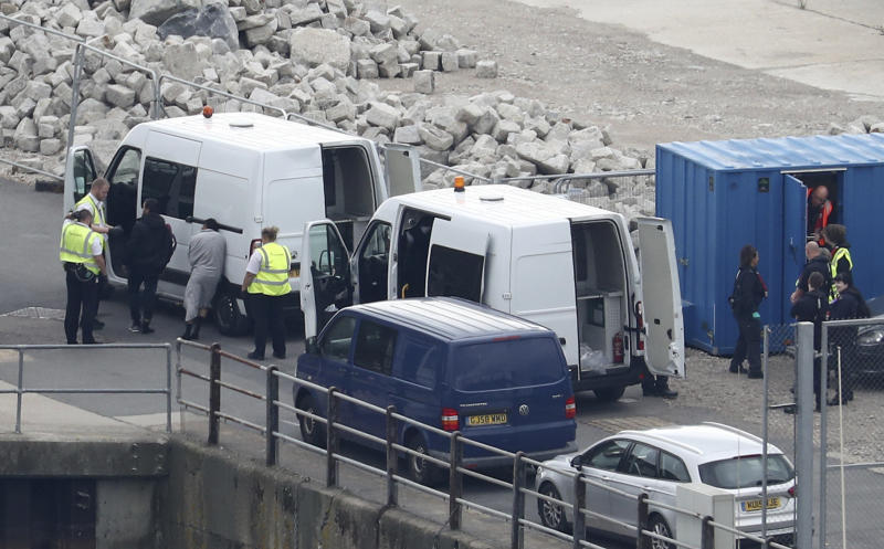 A group of people thought to be migrants are brought to shore by Border Force officers after a small boat incident in the English Channel at the Port of Dover in Kent, England. Monday Sept. 16, 2019. Gareth Fuller/PA via AP)