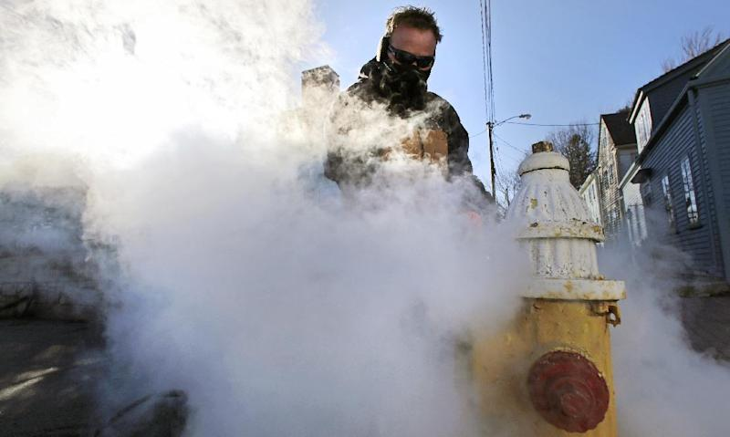 Jon Gilbert, of the Portsmouth, N.H. water department, steams a frozen hydrant in Portsmouth, N.H., Wednesday, Jan. 23, 2013.  Temperatures in New Hampshire hovered close to single digits, with wind chill temperatures going below zero for most of the day. (AP Photo/Charles Krupa)