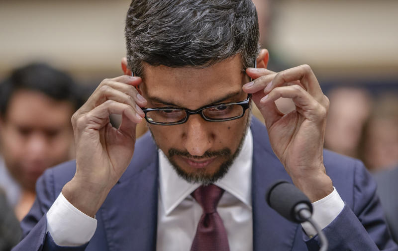 FILE- In this Dec. 11, 2018, file photo Google CEO Sundar Pichai appears before the House Judiciary Committee to be questioned about the company's privacy security and data collection, on Capitol Hill in Washington. Support for a privacy law is part of a broader effort by regulators and lawmakers to lessen the domination of companies like Facebook, Google and Amazon. Some, including Sen. Elizabeth Warren, a Democratic presidential candidate, have called for the tech giants to be split up. (AP Photo/J. Scott Applewhite, File)