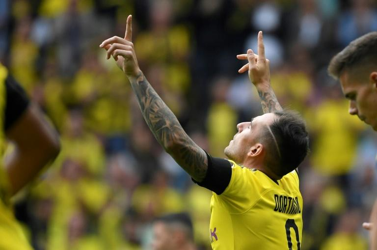 Dortmund striker Paco Alcacer pays tribute to his late father every time he scores