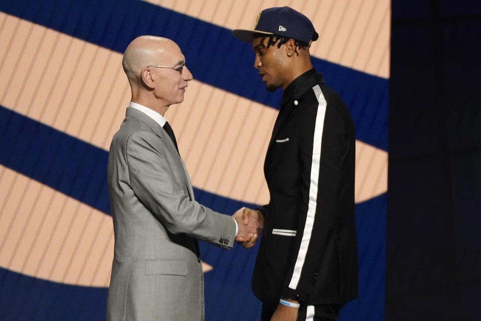 Ziaire Williams greets NBA Commissioner Adam Silver after being selected tenth overall by the New Orleans Pelicans during the NBA basketball draft, Thursday, July 29, 2021, in New York. (AP Photo/Corey Sipkin)