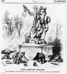 An illustration of Andrew Jackson riding a horse on a statue with the words, 'To the victors belong the spoils,' while several men seeking jobs bow down to him.