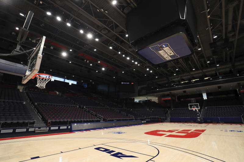 A view of the March Madness logo inside the Dayton Arena, Friday, March 13, 2020, in Dayton, Ohio. The coronavirus outbreak has abruptly roused the University of Dayton from its dream of a basketball season. The 29-2 Flyers were rolling into tournament play on a 20-game winning streak that had lifted spirits in an Ohio city battered in the past year by violent deaths and devastation. The NCAA decision to cancel March Madness ended hopes for the small Roman Catholic school's first Final Four appearance in 53 years. (AP Photo/Aaron Doster)