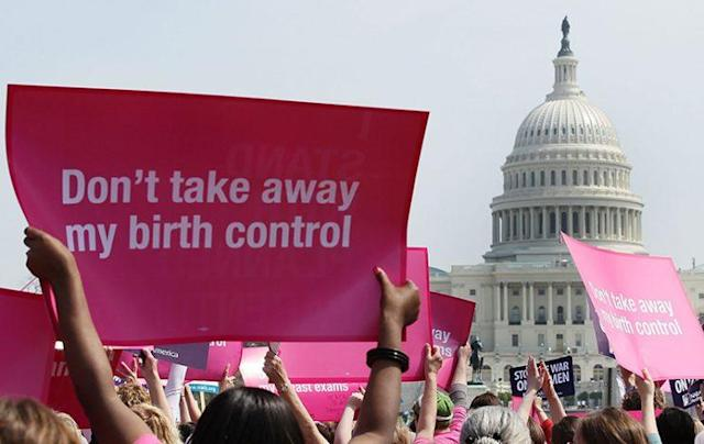Planned Parenthood supporters participate in a rally on Capitol Hill on April 7, 2011 in Washington, DC. Anti-abortion activists also held a rally opposing federal funding for Planned Parenthood. (Photo by Mark Wilson/Getty Images)