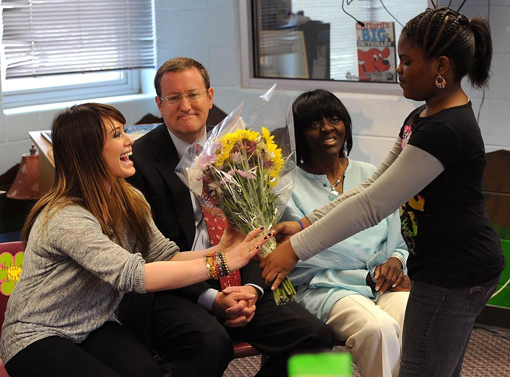 """The students and staff thanked the 23-year-old with flowers. Hilary just was happy she made it there! That morning she had tweeted, """"Heading to airport to visit blessing in a backpack school in Atlanta! the rain storm in la is nuts! My dogs were howling so much this morning."""" Rick Diamond/<a href=""""http://www.gettyimages.com/"""" target=""""new"""">GettyImages.com</a> - March 21, 2011"""