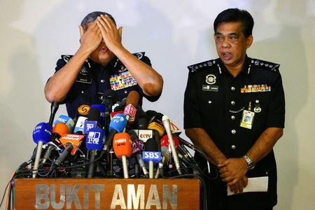 FILE PHOTO: Malaysia's Royal Police Chief Khalid Abu Bakar demonstrates to the media during a news conference regarding the apparent assassination of Kim Jong Nam, the half-brother of the North Korean leader, at the Malaysian police headquarters in Kuala Lumpur, Malaysia, February 22, 2017. REUTERS/Athit Perawongmetha/File Photo