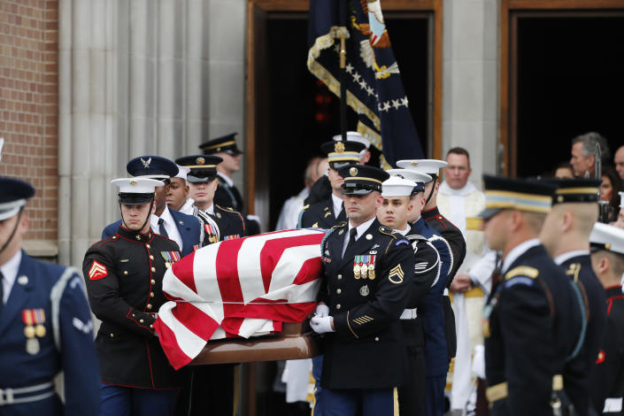 A military honor guard carries the flag-draped casket of former President George H.W. Bush from St. Martin's Episcopal Church following his funeral service Thursday, Dec. 6, 2018, in Houston. (Photo: Gerald Herbert/AP)