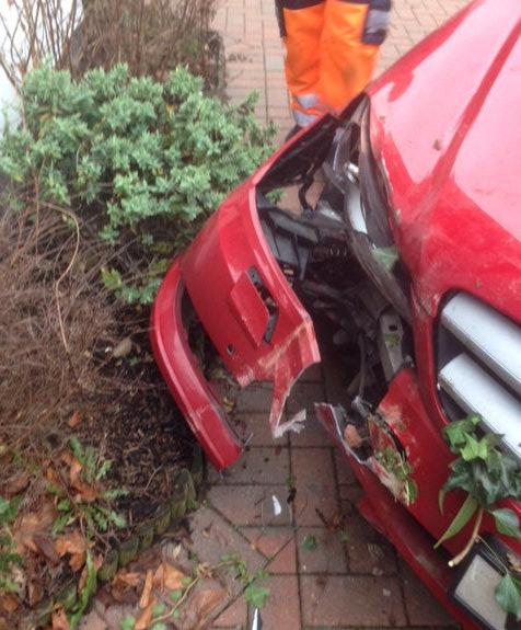 The Mercedes was shunted into the corner of the house (Picture: SWNS)