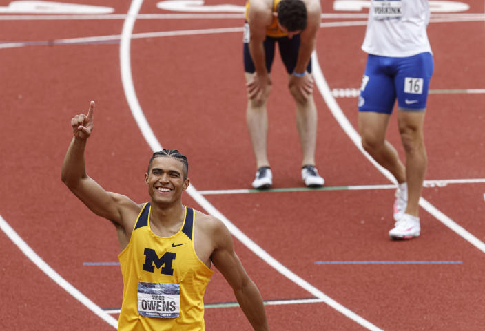 Michigan's Ayden Owens celebrates his win in the decathlon 1,500 meters to take second overall during the NCAA Division I Outdoor Track and Field Championships, Thursday, June 10, 2021, at Hayward Field in Eugene, Ore. (AP Photo/Thomas Boyd)