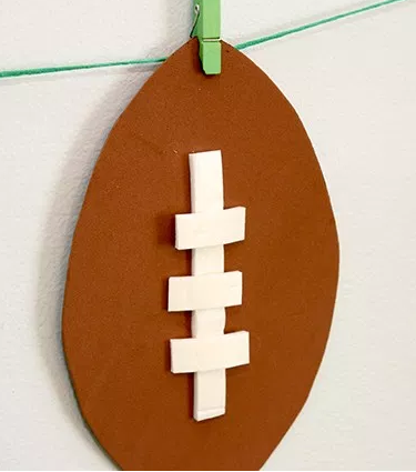 "<p>These cute little footballs are easy to make and so versatile. You can hang them by a string like this blogger did, or stick 'em somewhere else — the choice is yours. </p><p><em><a href=""http://www.ohsolovelyblog.com/diy-super-bowl-party-decor/"" rel=""nofollow noopener"" target=""_blank"" data-ylk=""slk:Get the tutorial at Oh So Lovely »"" class=""link rapid-noclick-resp"">Get the tutorial at Oh So Lovely »</a></em> </p>"