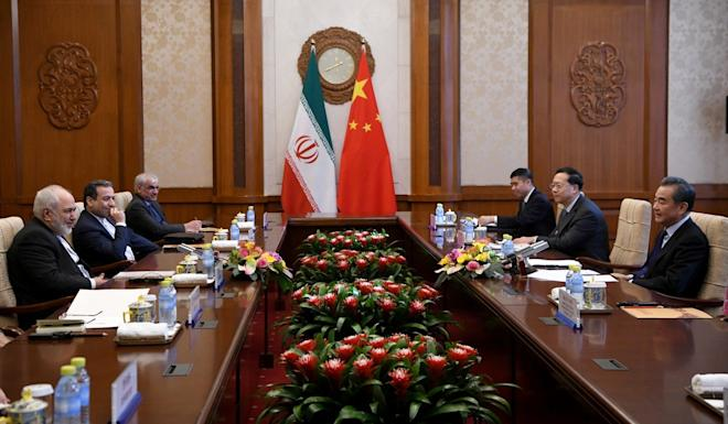 "During talks in Beijing, Wang Yi (right) told Mohammad Javad Zarif (left) that China would ""oppose any unilateralism and bullying behaviour"". Photo: Reuters"