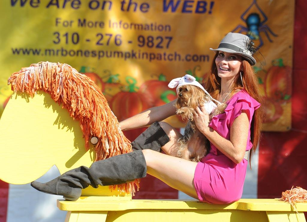 """""""What Were They Thinking?!"""" regular Phoebe Price made a trip to the patch cuddled up with a furry friend ... which would have been fine if she hadn't inexplicably outfitted the pooch in a bunny hat! Wrong holiday, Phoebe! VLUV/<a href=""""http://www.splashnewsonline.com"""" target=""""new"""">Splash News</a> - October 12, 2010"""
