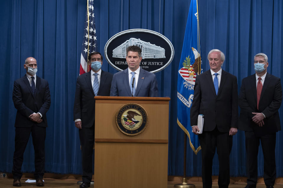 FBI Deputy Director David Bowdich speaks, Wednesday, Sept. 16, 2020 at the Justice Department in Washington. The Justice Department has charged five Chinese citizens with hacks targeting more than 100 companies and institutions in the United States and abroad, including social media and video game companies as well as universities and telecommunications providers. Officials announced the prosecution on Wednesday. (Tasos Katopodis/Pool via AP)