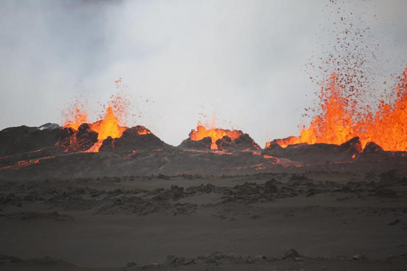 Lava flows from cracks in the ground after the Bardabunga volcano erupted again in the early hours on August 31, 2014